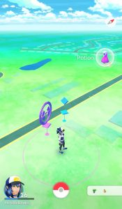 PokeStops - Purple visited Pokestop on left - you're close enough to activate it. Unvisited PokeStop on right.